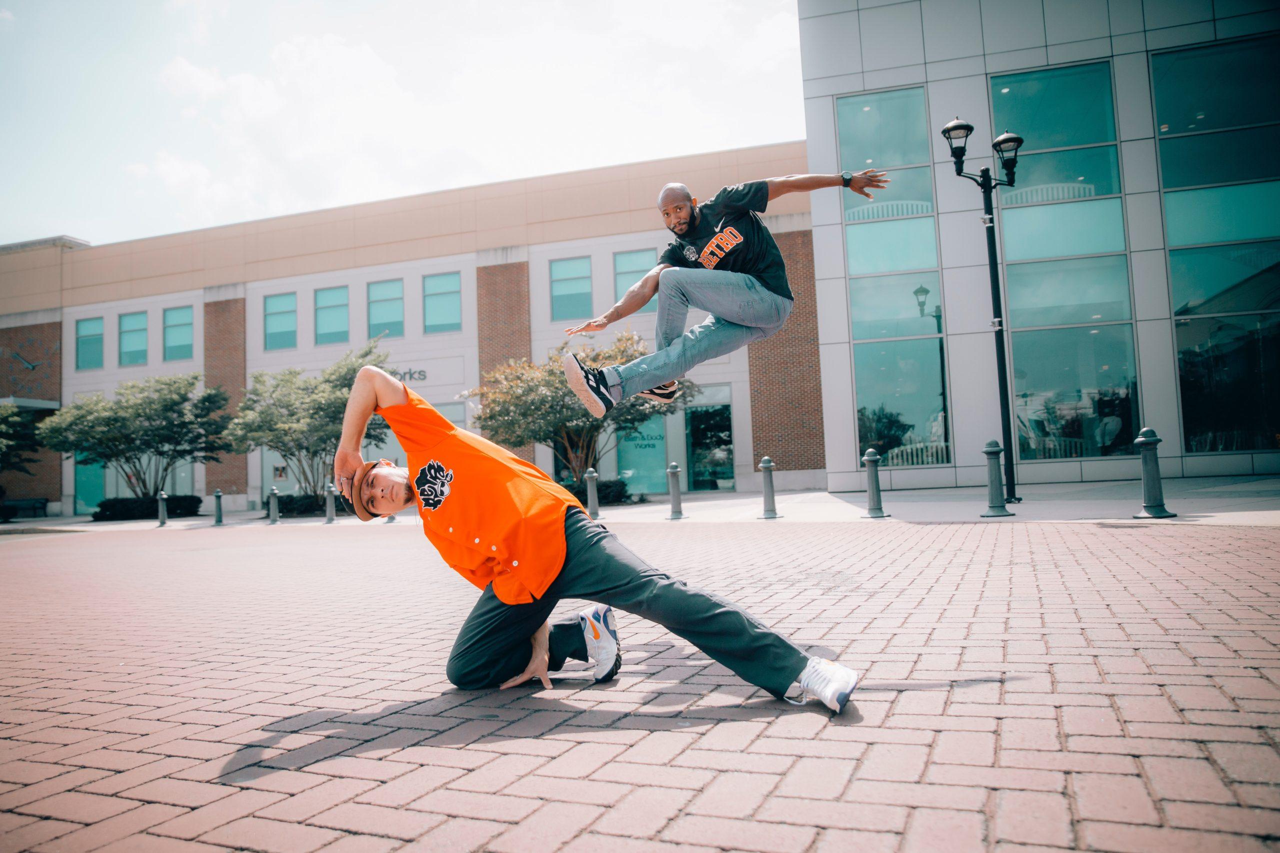 two-men-dancing-on-concrete-pavement-2895449